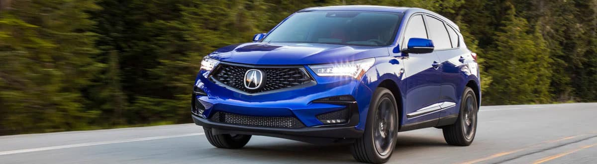 Blue Acura RDX Luxury SUV Driving