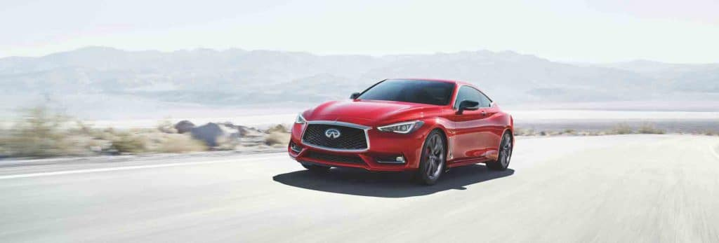 Bennett INFINITI of Wilkes-Barre is a Car Dealership near Back Mountain PA | 2020 INFINITI Q60 driving on desert road