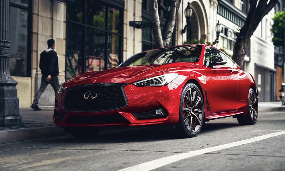 Bennett INFINITI of Wilkes-Barre is a Car Dealership near Wilkes-Barre PA | Red 2021 INFINITI Q60 Street Parked in City
