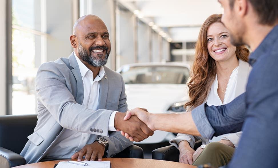 Bennett INFINITI of Wilkes-Barre is a Car Dealership near Scranton PA | Couple Meeting with Financial Advisor in Dealership