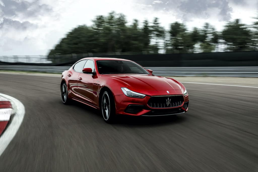Bennett Maserati of Allentown is a Car Dealership in Allentown   2021 Maserati Ghibli driving on race track
