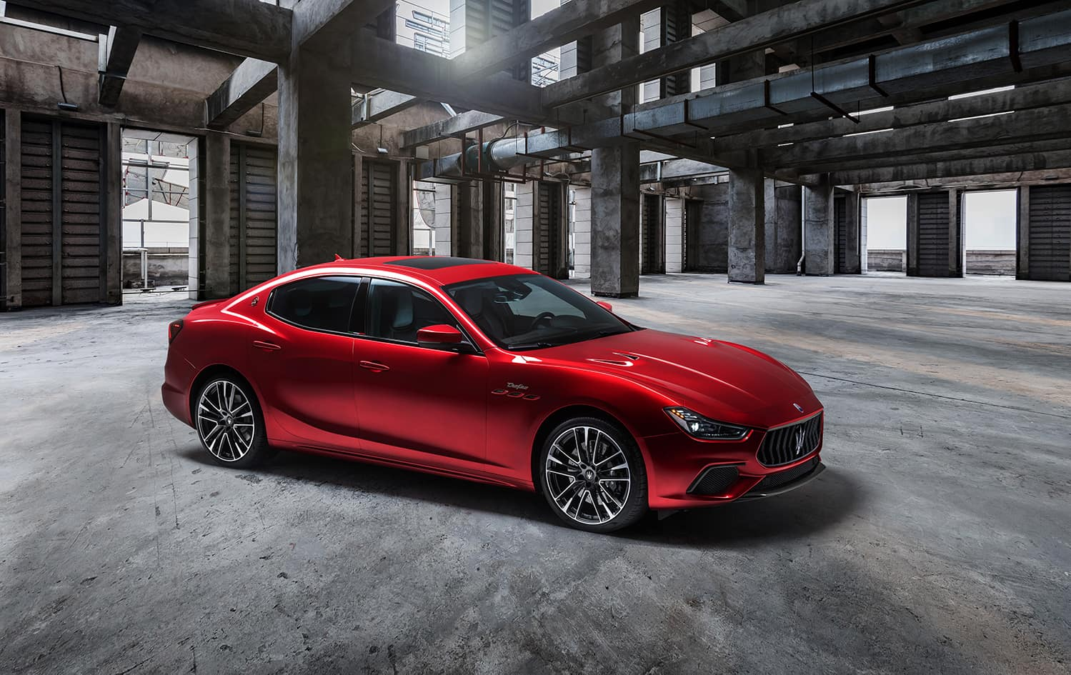 2021 Maserati Ghibli parked in industril building | Bennett Maserati of Allentown is a Car Dealership near East Stroudsburg PA in Allentown