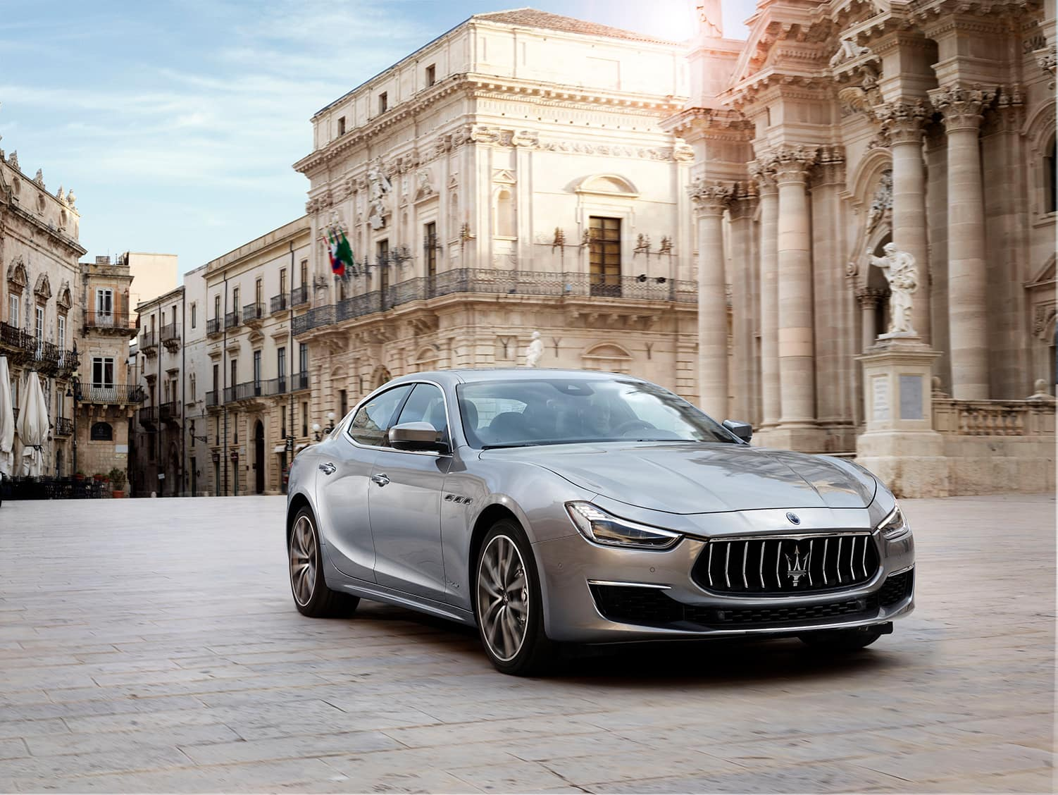 Bennett Maserati of Allentown is a Car Dealership near Westwood Heights PA in Allentown | 2020 Maserati Ghibli parked outside of Italian buildings