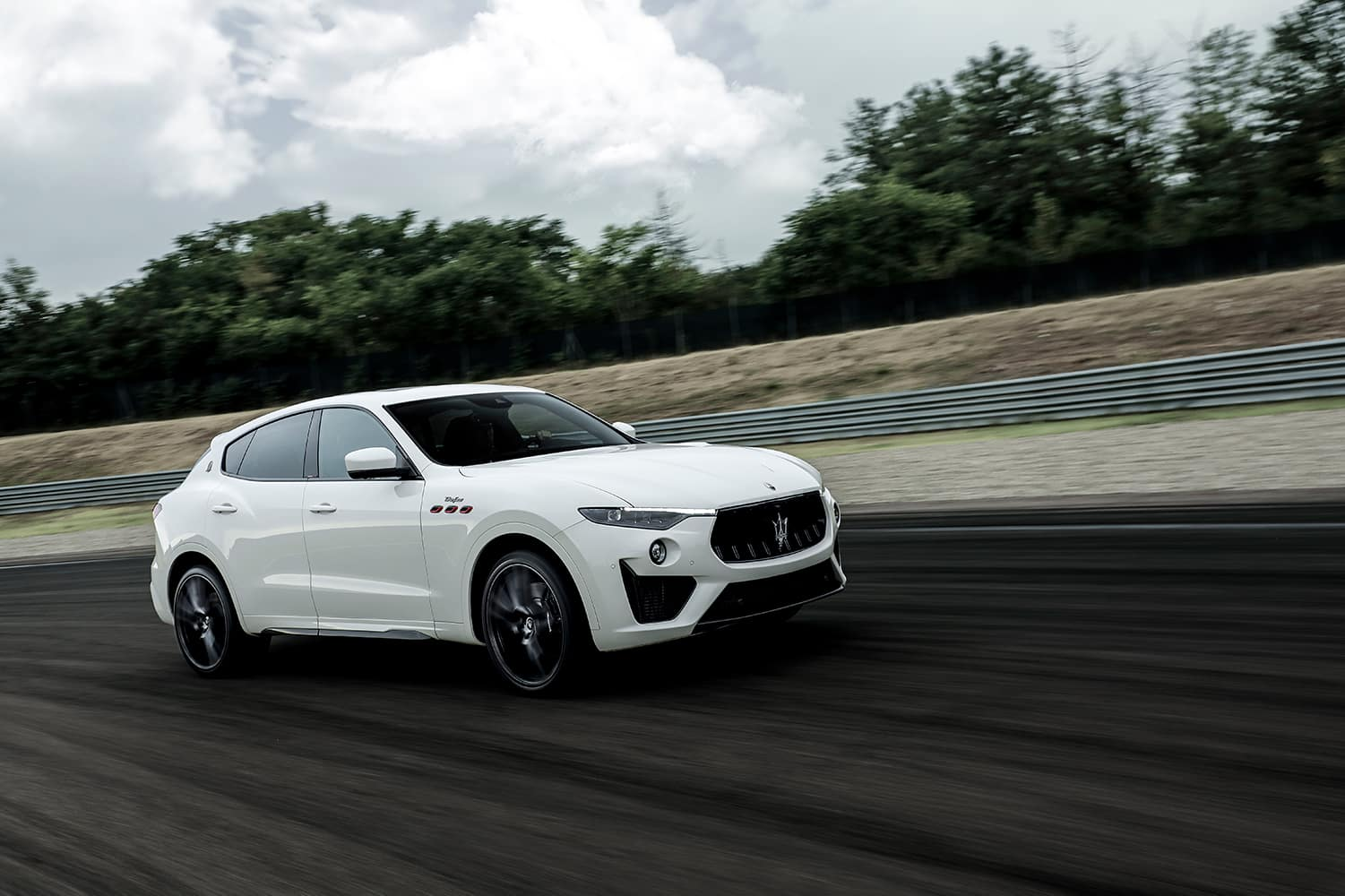 2021 Maserati Levante driving down road | Bennett Maserati of Allentown is a Car Dealership near Wescosville PA in Allentown