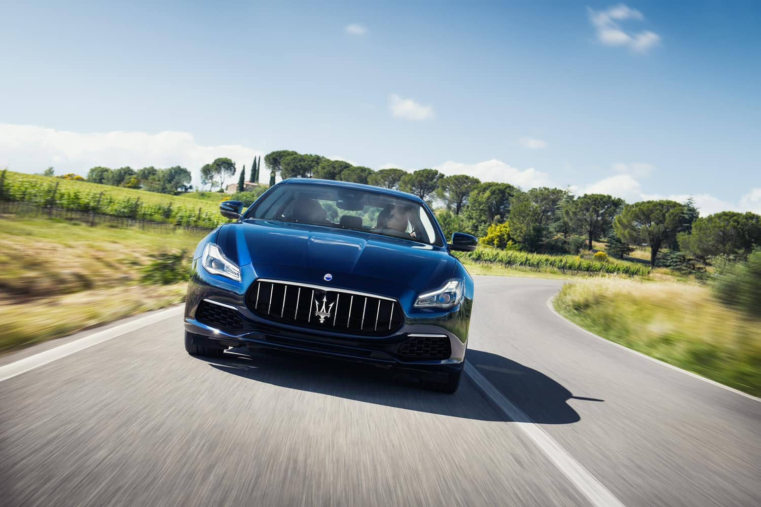 2020 Maserati Quattroporte driving through country roads | Bennett Maserati of Allentown is a Car Dealership near Wescosville PA in Allentown