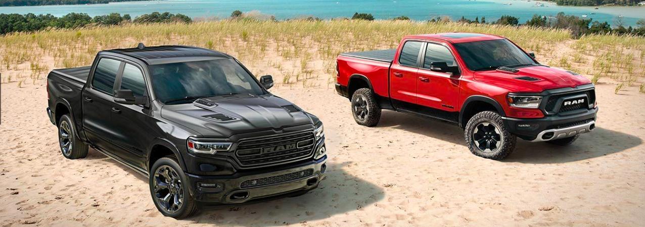 Two 2020 RAM 1500 Trucks on a Beach