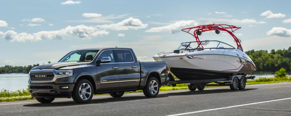 A 2021 RAM 1500 towing a boat