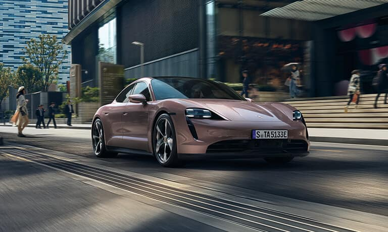 2021 Porsche Taycan driving in the city