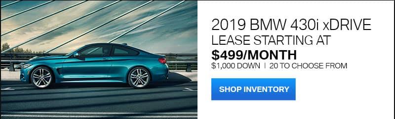 2019 BMW 430i driving on a bridge