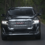 2020 GMC Acadia driving on road