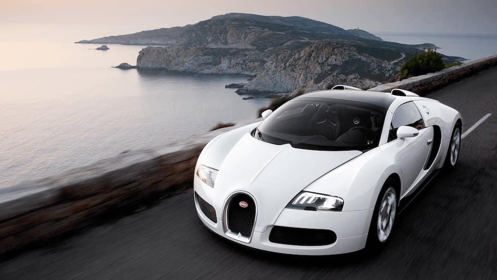 Bugatti Veyron Driving Along Ocean Curve