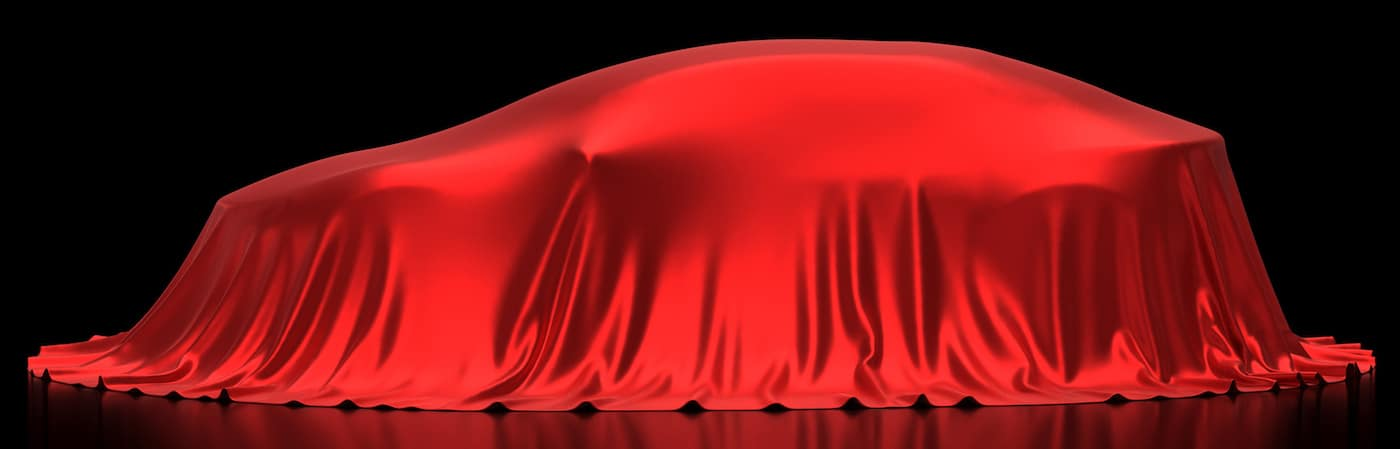 SUV Under a Sheet Waiting to Be Unveiled