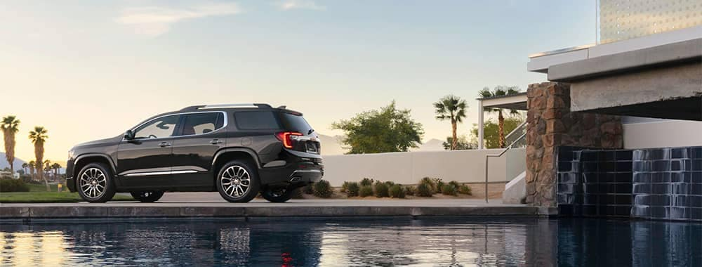 GMC Acadia Parked Outside Beautiful Home with In-Ground Pool