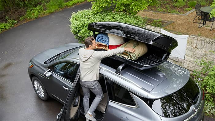Man loading Buick Enclave Roof Cargo Accessory
