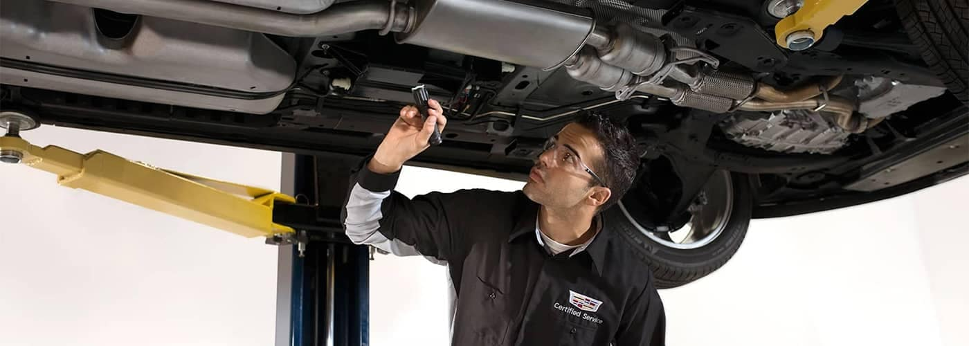 Cadillac Service Technician Working on Car