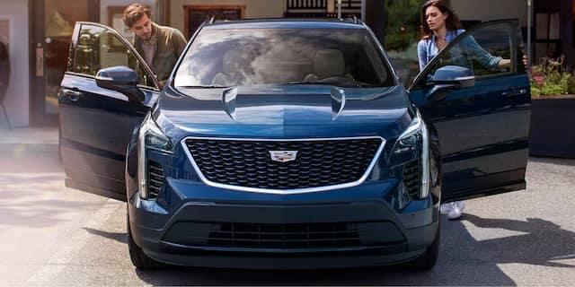 Couple getting into a Cadillac XT4