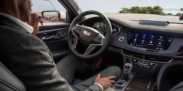 Man Driving Cadillac