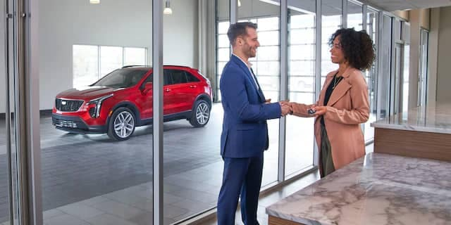 Man dropping Cadillac off to service department