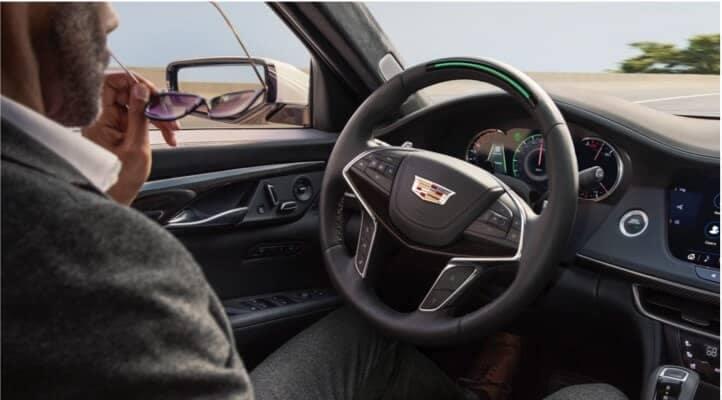 Man driving a Cadillac CT6