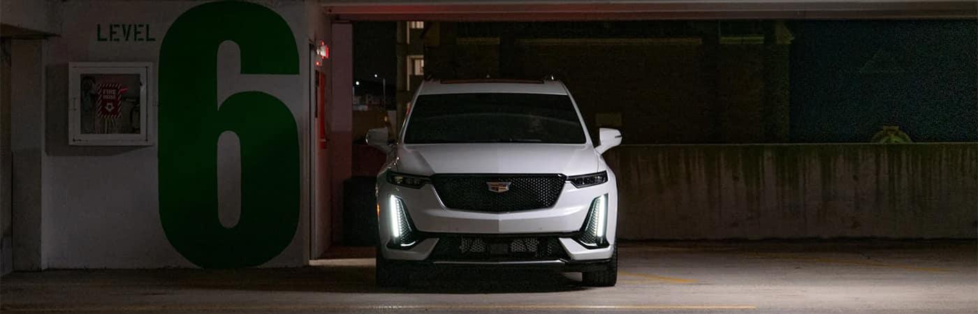 Cadillac SUV Parked in Parking Garage