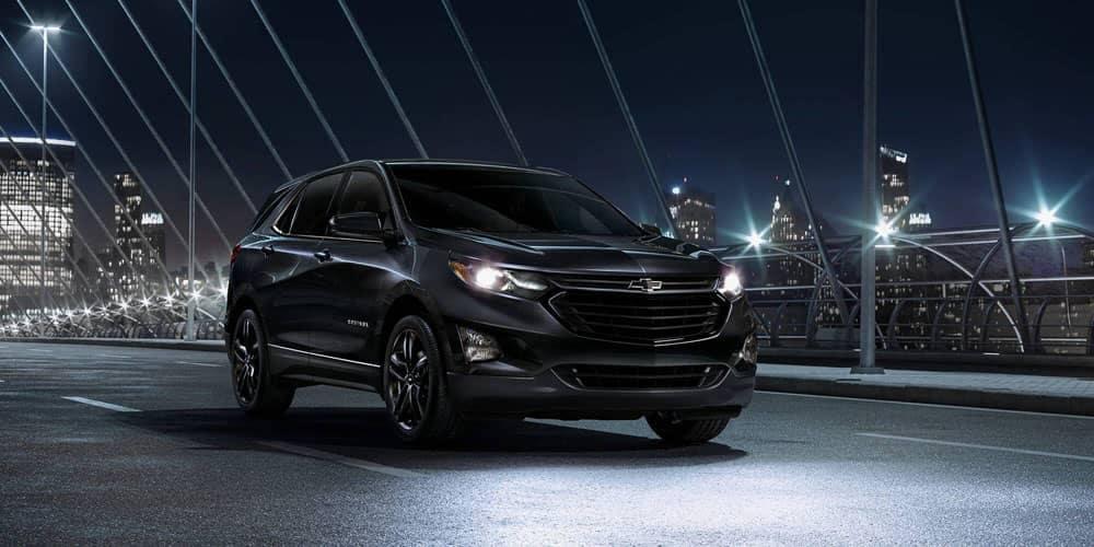 2020 Chevrolet Equinox on a bridge at night time