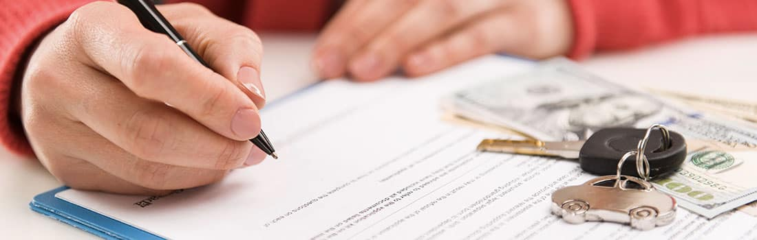 finance signing paperwork for a credit loan