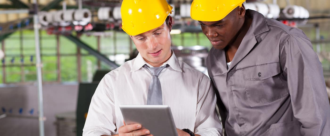 manufacturer workers with hardhats