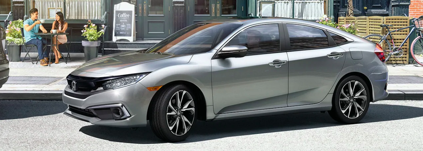 2020 honda civic silver exterior pulling out of the parking space