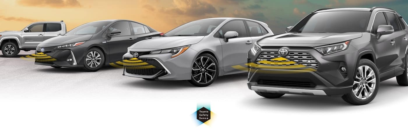 Row of new Toyota Cars with Toyota Safety Sense Graphic