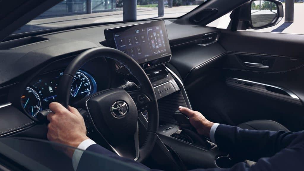 mans hands on steering wheel of 2021 toyota venza