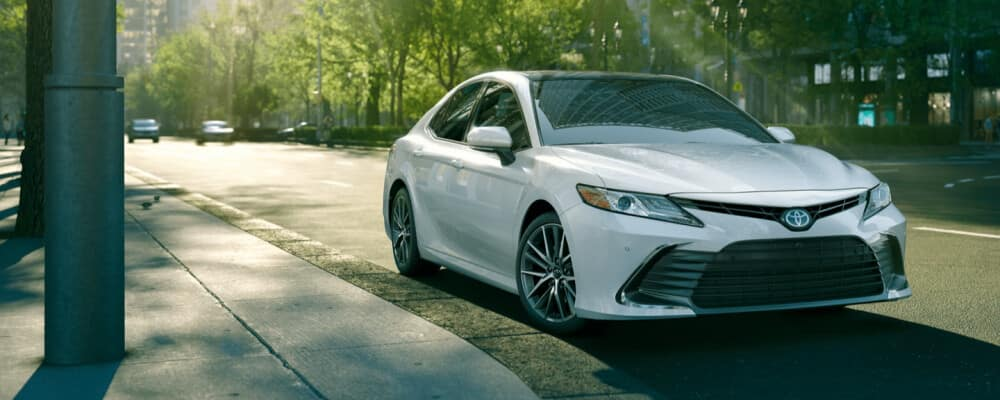 2021 Toyota Camry driving down city street
