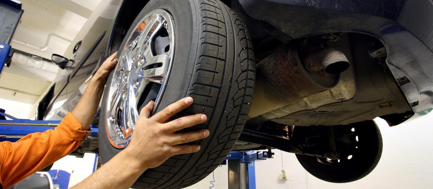 Auto Mechanic Performing Routine Car Maintenance
