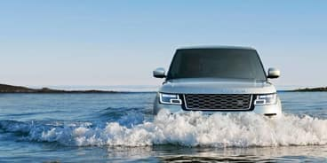 Land Rover Plug in Hybrid Driving in Water