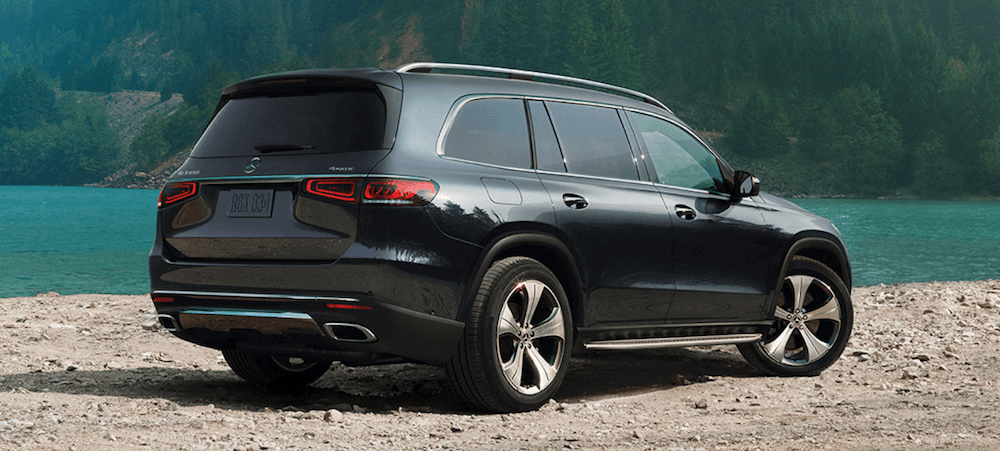 2020 Mercedes-Benz GLS parked by lake price banner