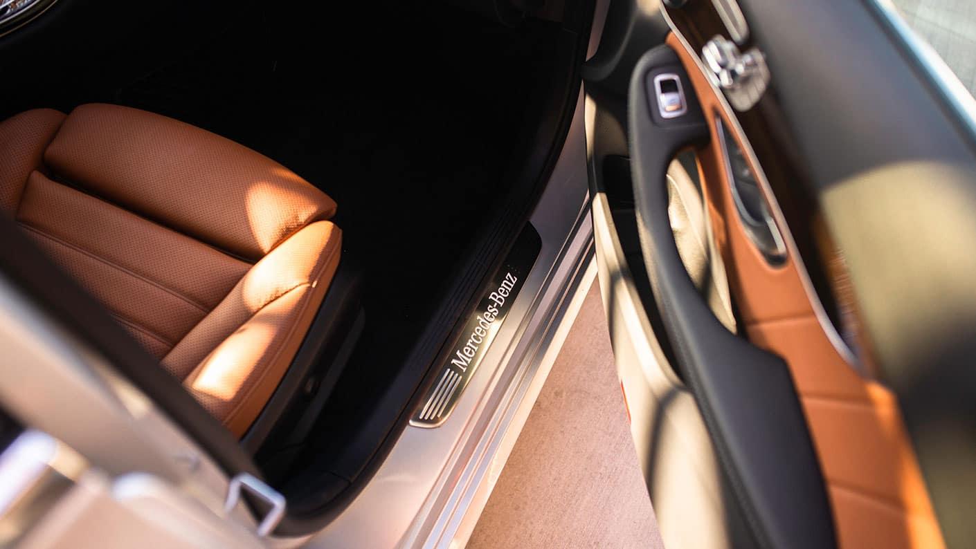 2019-Mercedes-Benz-C-Class-Sedan-stepping-through-door