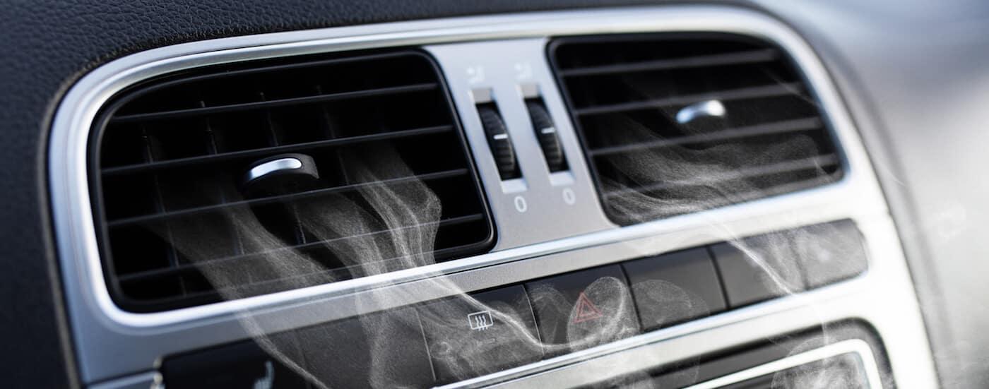 Close up of car air vents showing car mold particles