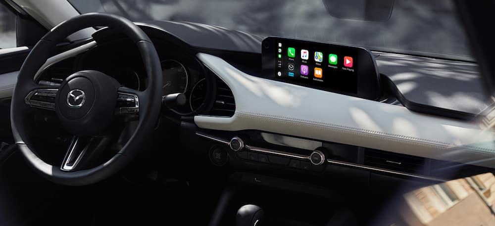 The dashboard of a 2020 Mazda3 sedan with Apple CarPlay