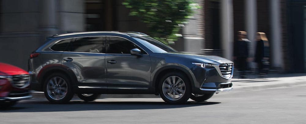A 2019 Mazda CX-9 driving on a city street