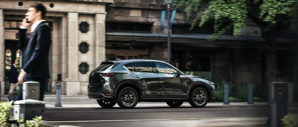 A 2020 Mazda CX-5 driving down a city street