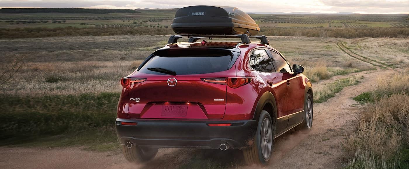 A financed 2020 Mazda CX-30 driving off-road in a desert