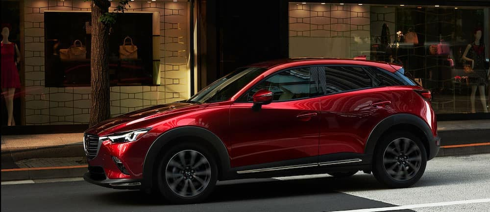 A 2020 Mazda CX-3 driving on a city street