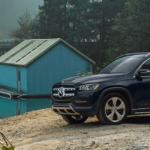 2020 Mercedes GLS suv near lake with cabin