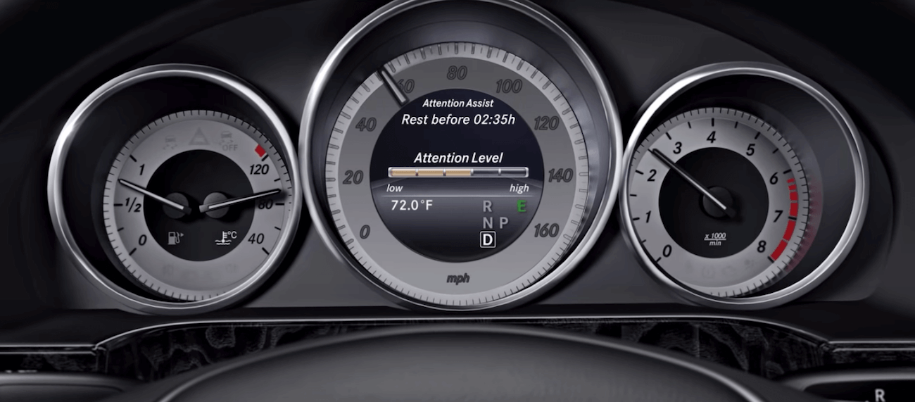 Mercedes-Benz driver's dashboard showing Mercedes-Benz Attention Assist drowsiness warning