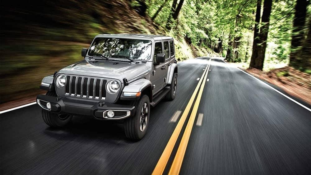 grey 2019 Jeep Wrangler driving