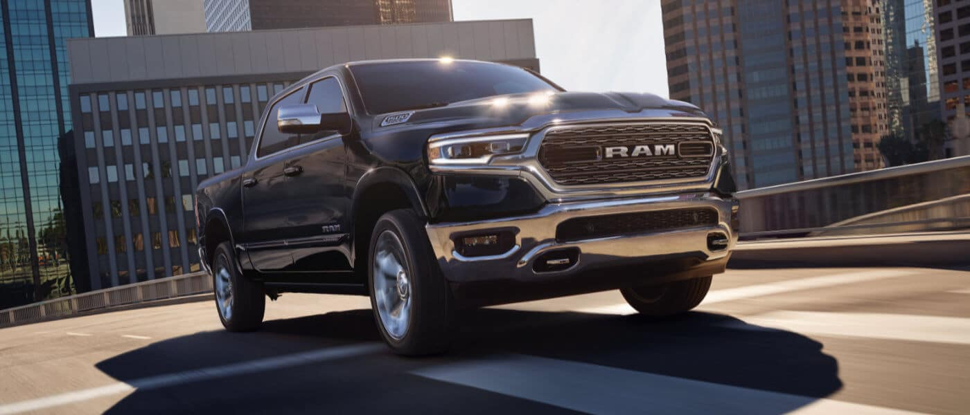 2020 ram 1500 driving on highway in city
