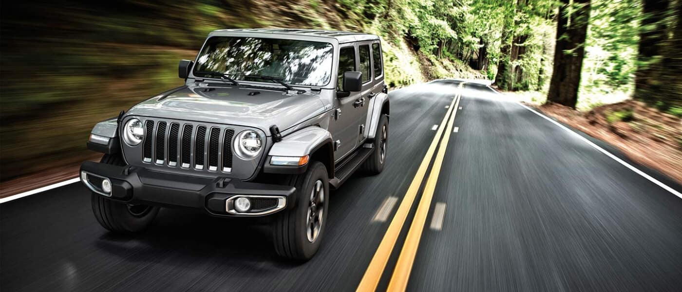 2020 Wrangler driving through forest