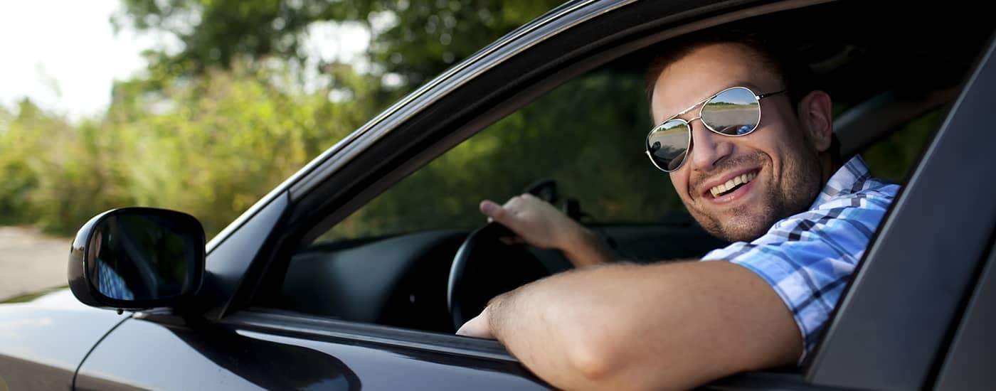 Man smiling sitting in car