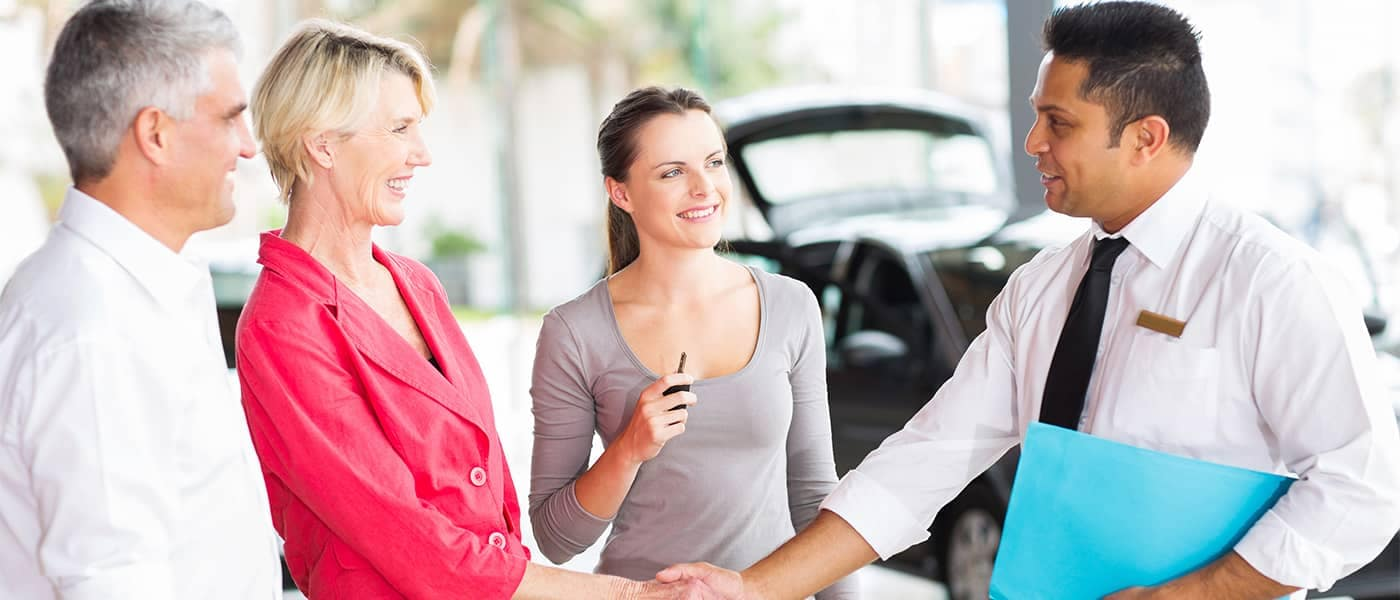 Parent and Child Buying a Car