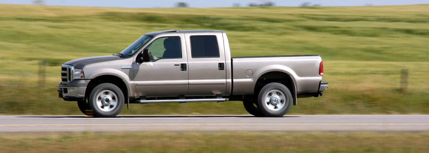Pickup Truck Driving Down Open Road