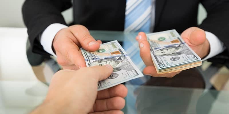 Business man handing money to customer